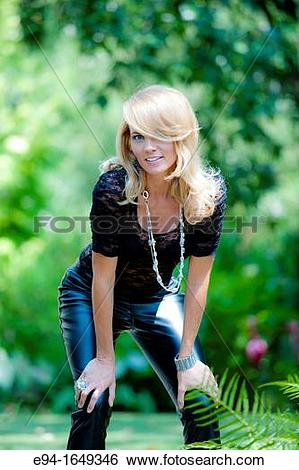 Stock Images of Portrait of a 34 year old blond woman in leather.