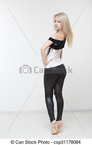 Pictures of Beautiful girl in black leather pants. on a white.