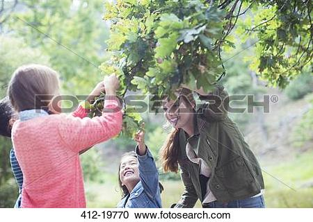 Stock Photography of Students and teacher examining leaves.