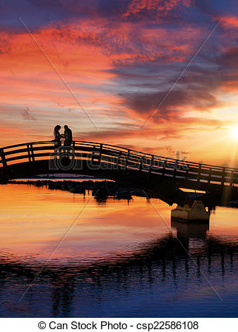 Stock Photography of Couple enjoying the romantic sunset on the.