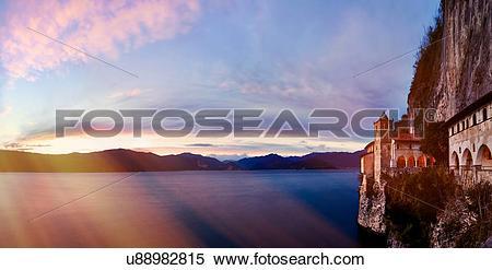 Stock Image of Sunrays over lake, Leggiuno, Lombardy, Italy.