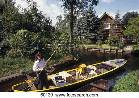 Stock Photograph of Woman rowing boat in canal, Spreewald, Lehde.