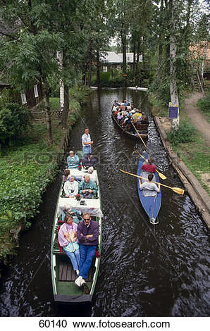 Stock Photography of High angle view of tourists on boats in canal.