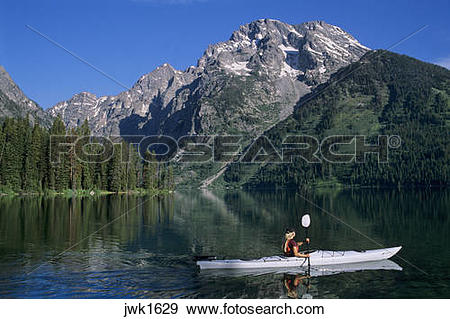 Stock Photograph of Kayaking on Leigh Lake below Mount Moran in.