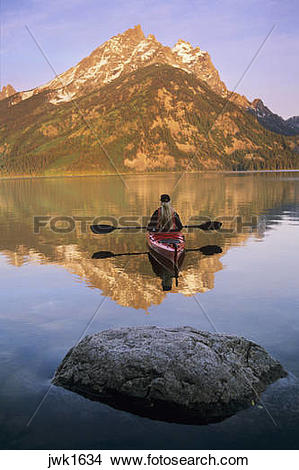 Stock Photo of Kayaking on Jenny Lake at sunrise below Teewinot.
