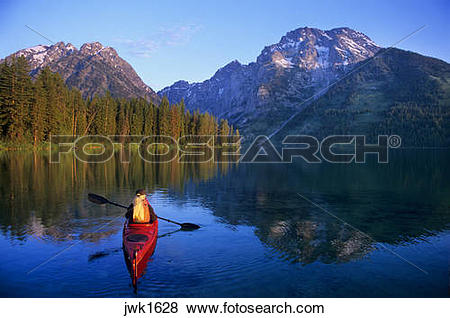 Pictures of Woman kayaking on Leigh Lake beneath Mount Moran in.