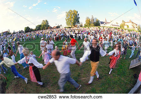 Stock Photo of People dancing around Maypole during Midsummer.