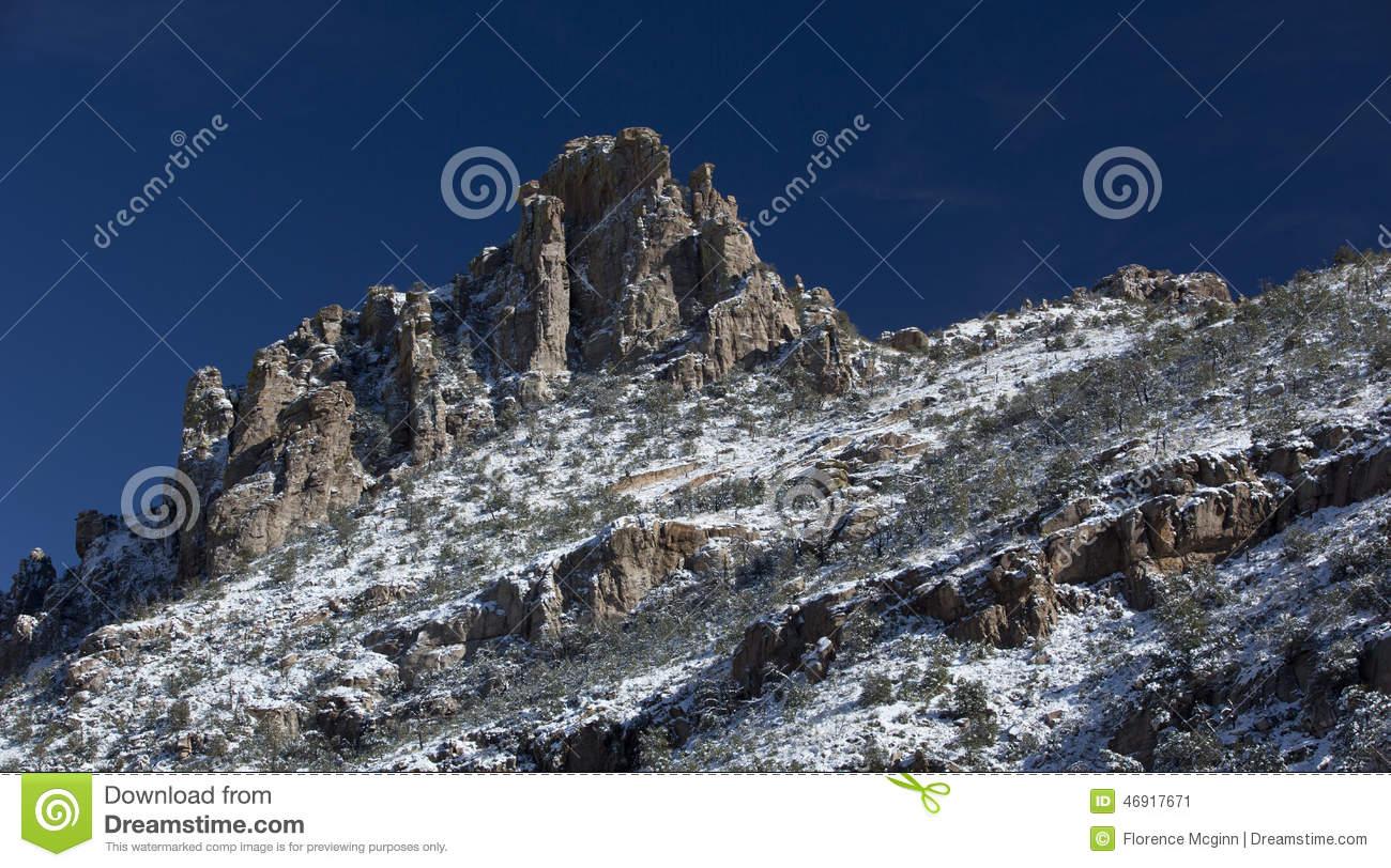 Snow Dusts Catalina Mountain Peak On Mt. Lemmon Stock Photo.