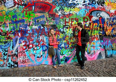 Stock Images of John Lennon wall in Prague and young beautiful.