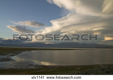 Stock Photography of A lenticular cloud at sunset over Crowley.