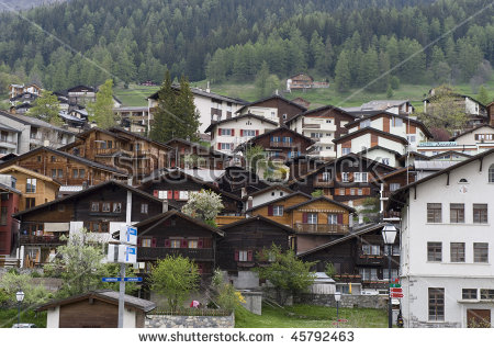 Traditional Wooden House Built Along Mountain City.