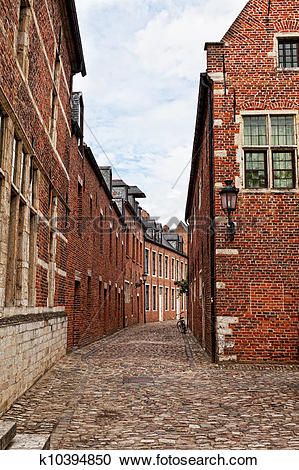 Stock Photography of Narrow cobblestone street in a medieval.