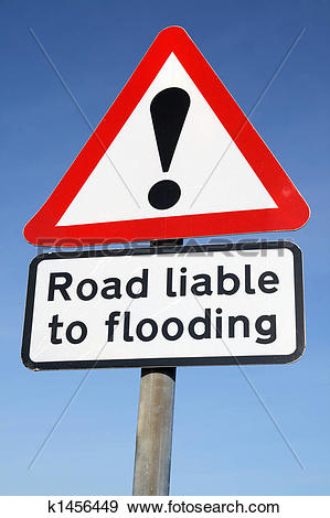 Stock Photograph of Road liable to flooding warning sign and a.