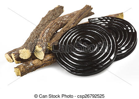 Stock Photo of Licorice roots and licorice black on the white.