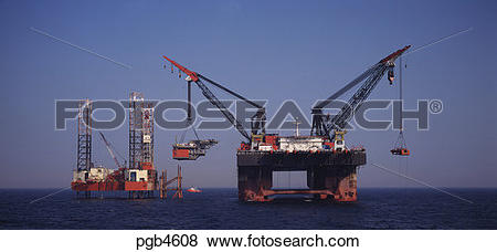 Pictures of England. North Sea. Derrick barge lifting topside of.