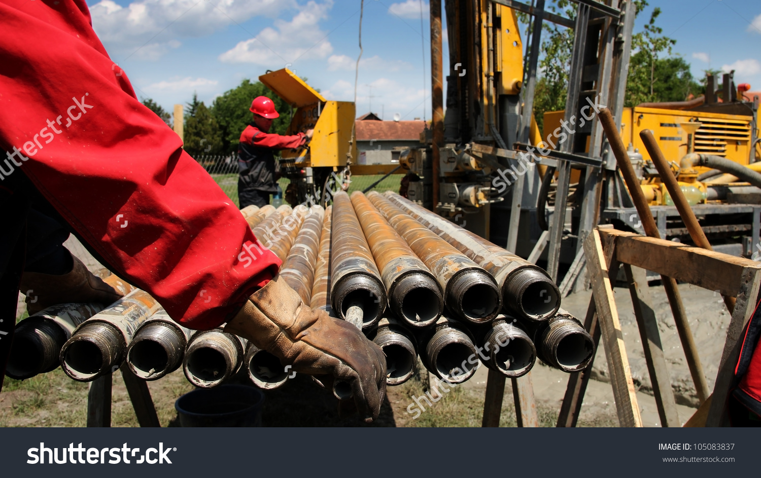Oil Drilling Rig Workers Lifting Drill Pipe. Oil And Gas Industry.