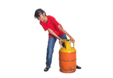 Young Girl Lifting Cooking Gas Cylinder I Stock Photo.