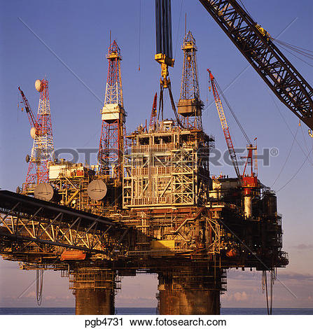 Stock Photography of Lifting gas compression module onto oil.
