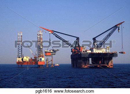 Stock Images of England. North Sea. Derrick barge lifting topside.