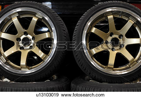 Stock Photograph of Custom light alloy wheels with low profile.