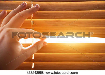 Pictures of Looking through window blinds, sun light coming inside.