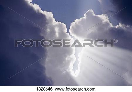 Stock Images of Beams of Light coming through hole in clouds.