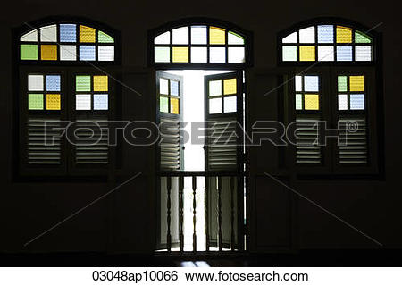 Stock Images of Light coming through old shop house stained glass.