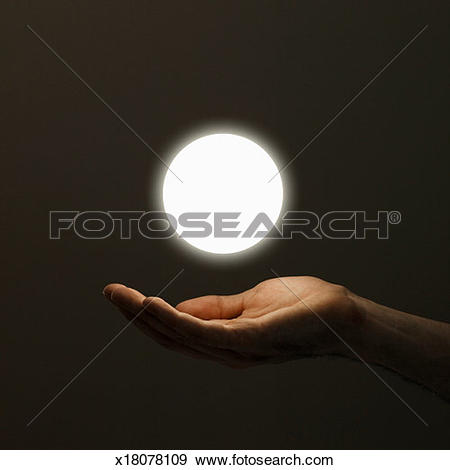 Stock Photograph of Hand below orb of light, close.