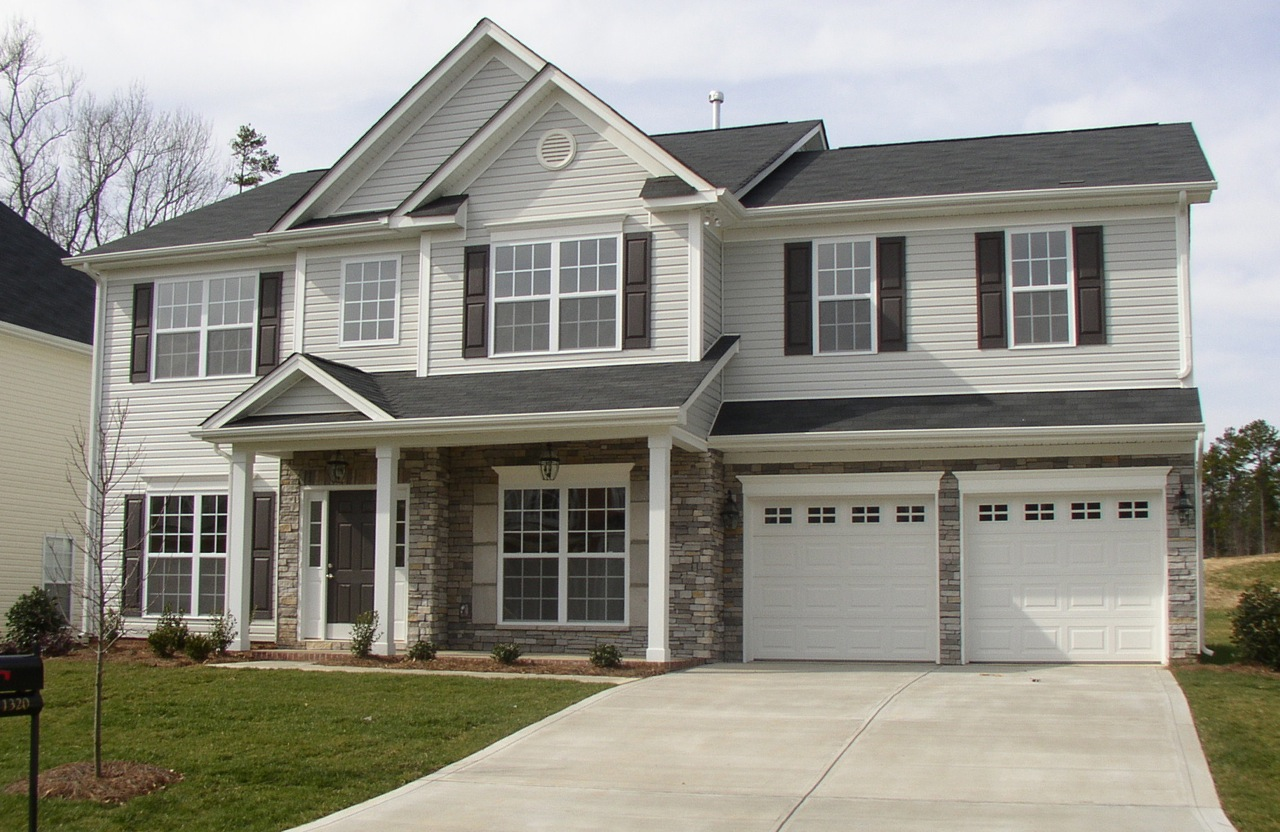 Color scheme. Light gray siding. White garage doors and trim. Gray.