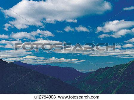 Stock Photo of sky, light, mountain, cloud, daytime, peak.