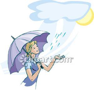 Woman Holding an Umbrella Under Light Rain.