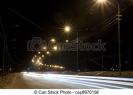 Stock Image of Night street with traces from light of headlights.