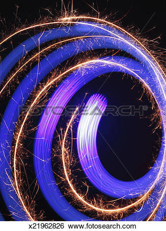 Stock Images of Spiral fiber optic light trail with sparks.