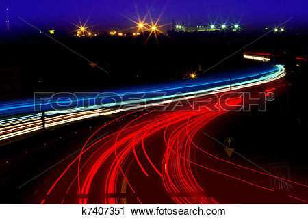Stock Photography of car light trails in red and white on night.