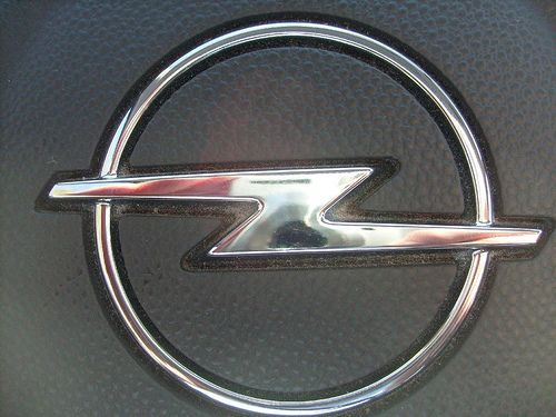 Silver Lightning Bolt Car Logo.