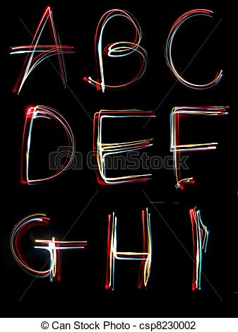 Stock Photo of alphabet light neon writing long exposure.