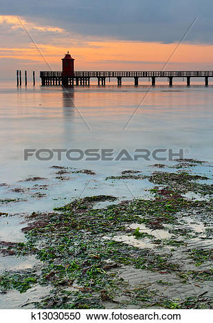 Stock Photography of Wooden pier and lighthouse in Lignano.