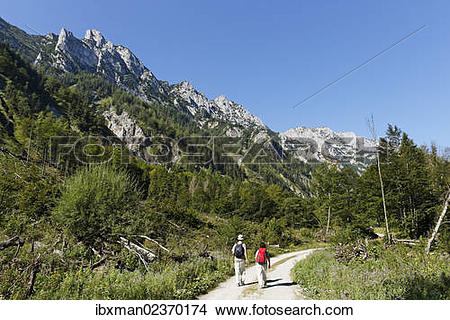 "Stock Photo of ""Pair hiking in the Sengsen Mountains in Limestone."