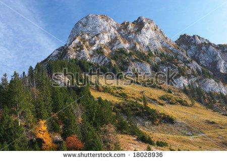 White Limestone Mountain And Autumn Forest In Jura, Switzerland.
