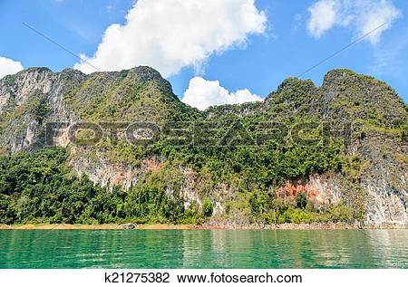 Stock Photo of Lush high limestone mountains. k21275382.