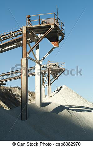 Stock Photography of Machinery in a limestone quarry.Piles of.