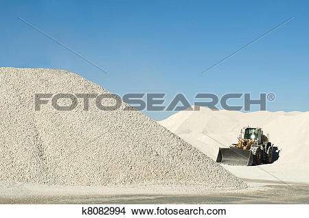 Stock Photo of Excavator in a limestone quarry k8082994.
