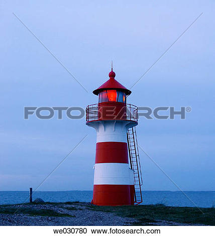 Stock Photography of Lighthouse showing red light in the night.