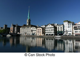 Stock Photography of Fraumuenster and Limmat river in Zurich night.