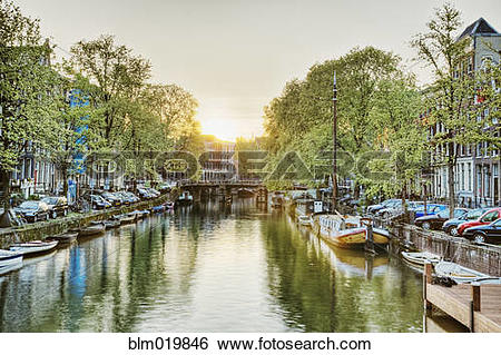 Stock Images of Boats Moored in a Tree Lined Canal at Daybreak.