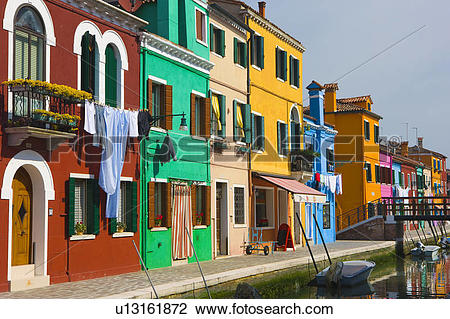 Stock Photo of Colourful buildings lining canal, island of Burano.