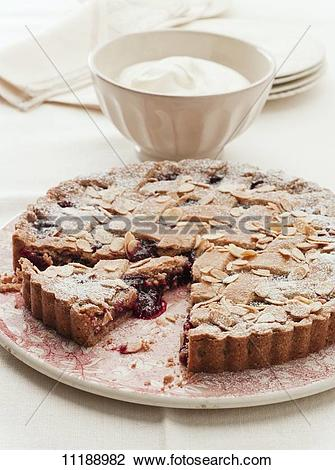 Stock Photo of Linzer torte (nut and jam layer cake) with sliced.