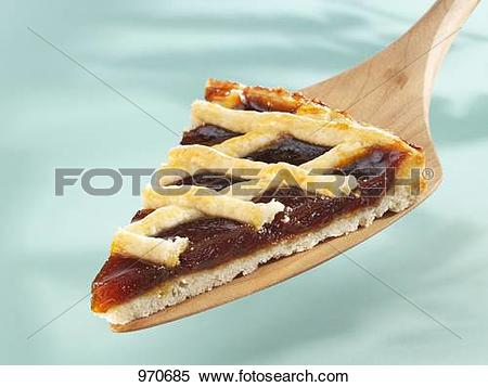 Stock Image of Piece of Linzer torte (lattice tart) on cake server.