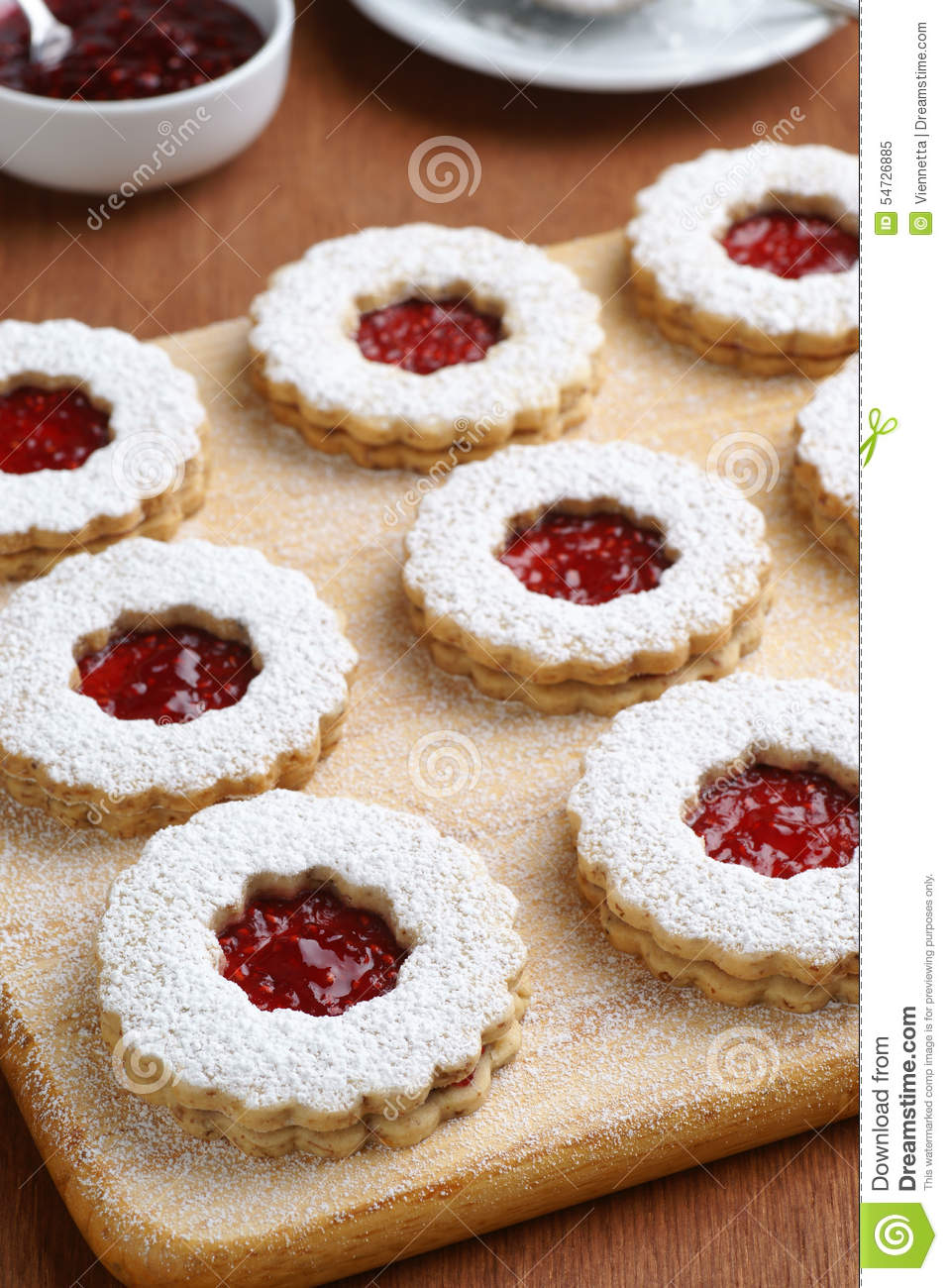 Raspberry Linzer Torte Cookies On Cutting Board Stock Photo.