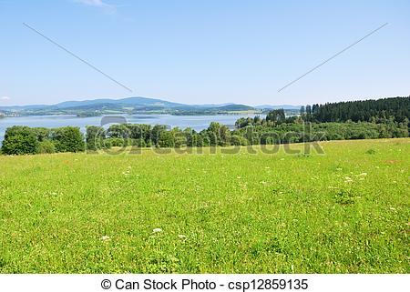 Stock Photos of Lipno dam reservoir and green hillside country.
